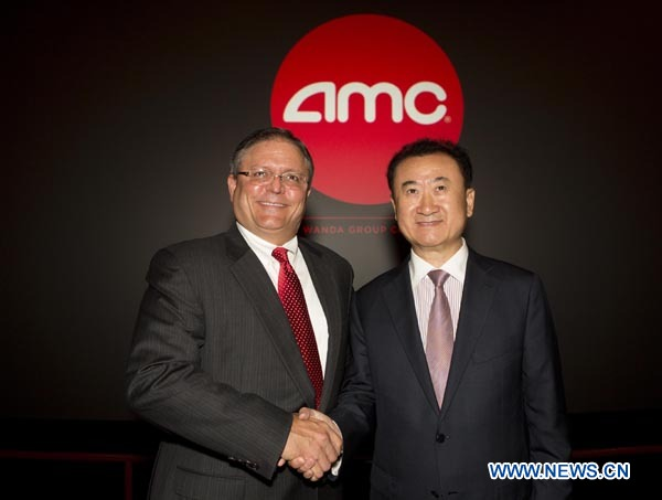 (120905) -- LOS ANGELES, Sept. 5, 2012 (Xinhua) -- Chairman and President Wang Jianlin (R) of China's Dalian Wanda Group Co. and AMC chief executive officer and president Gerry Lopez attend a press conference at an AMC theater in west Los Angeles, the United States, on Sept. 4, 2012. China's leading private conglomerate Dalian Wanda Group Co. on Tuesday completed a high-profile acquisition of AMC Entertainment Holdings, Inc., valued at roughly 2.6 billion U.S. dollars, in Los Angeles. (Xinhua/Zhao Hanrong) (nxl)
